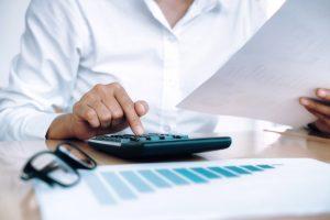 Baglin Tax Dep 300x200 - Finances Saving Economy concept. Female accountant or banker use
