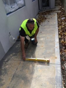 Checking a Pathway for Correct Fall Away from Dwelling Hub Lanyard PCI 225x300 - A Day in the Life of a Home Inspection Hub Inspector