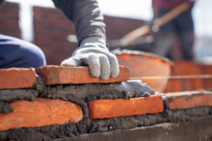 bricklayer industrial worker installing brick masonry with trowel putty knife construction site 33835 1135 300x200 - bricklayer-industrial-worker-installing-brick-masonry-with-trowel-putty-knife-construction-site_33835-1135